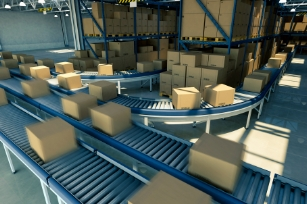 distribution warehouse packages on a conveyor